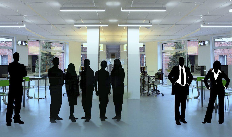 Mitarbeiter in einem Büro, aber schwarz gefärbt, also unkenntlich gemacht